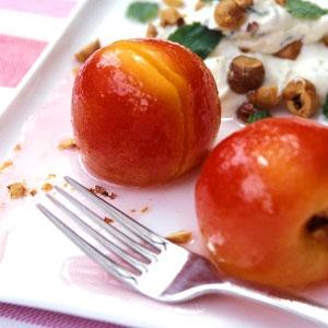 White Poached Nectarines with Sweetened Mint Cream & Toasted Hazelnuts